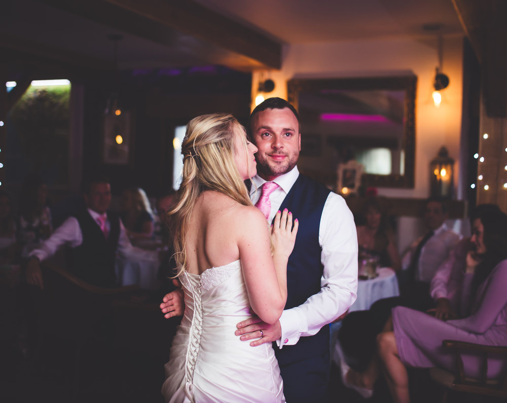 The bride and groom on the dance floor for their first dance- Creative wedding photography