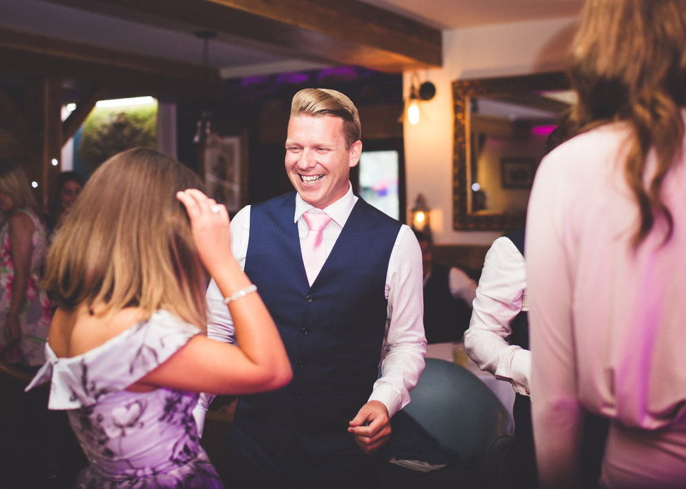 Groomsmen on the dance floor at Inn on the Lake, lake district
