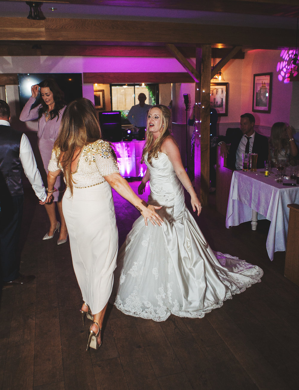 The bride and the dance floor at Inn on the Lake