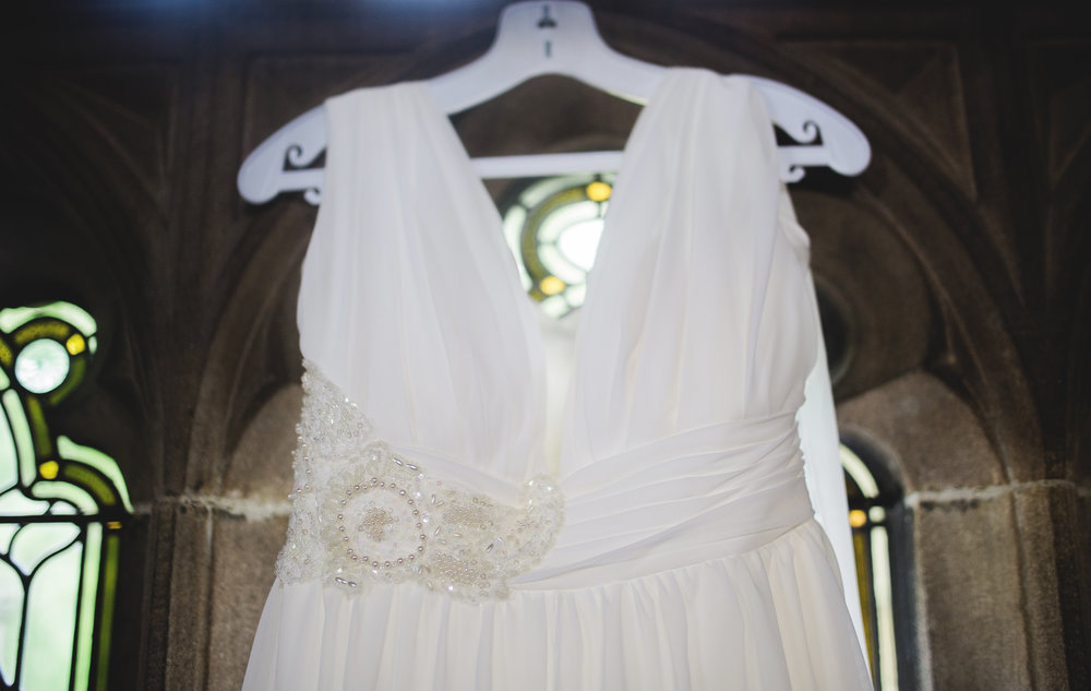 The wedding dress hung up at Whalley Abbey for a rustic themed wedding in lancashire