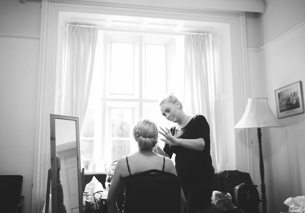 The bride getting her makeup done for the wedding in ribble valley, Whalley Abbey for a wedding venue- Lancashire photographer