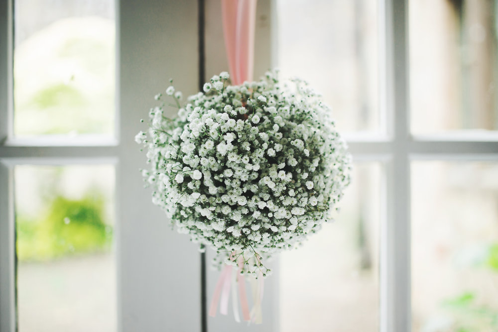 Beautiful flowers hunt at the door- Rustic themed wedding at Whalley Abbey