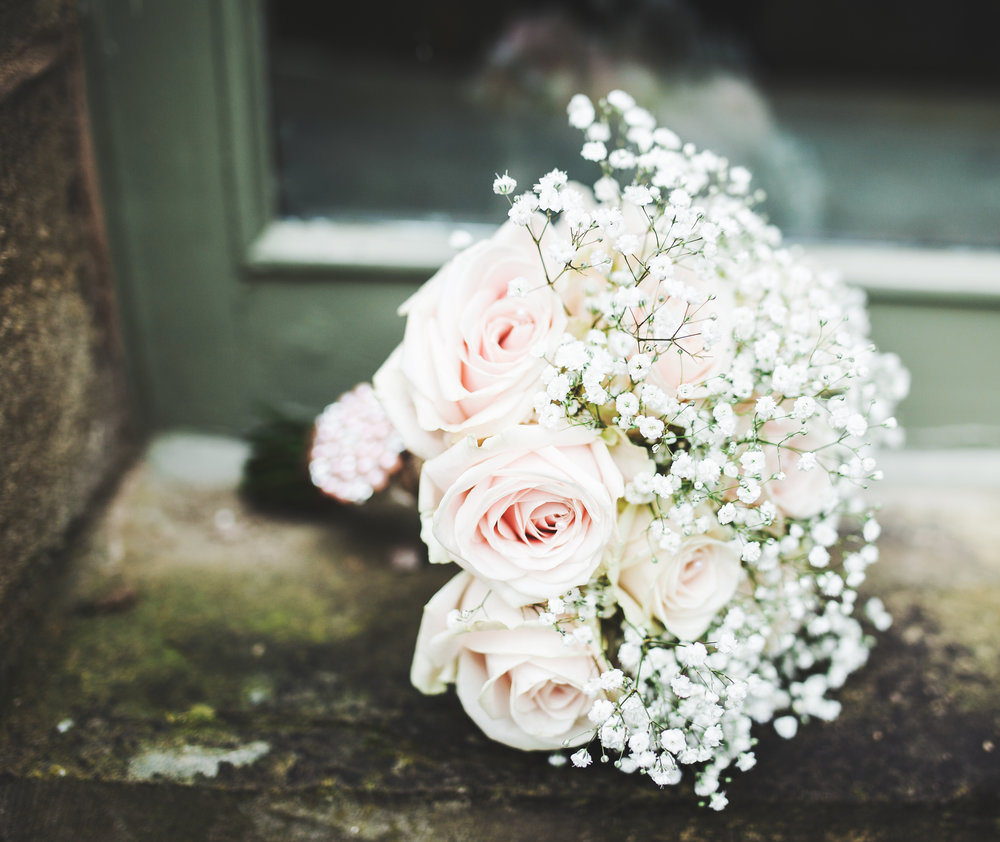 The pale pink flower bouquet on the ground- Creative wedding photography in ribble valley