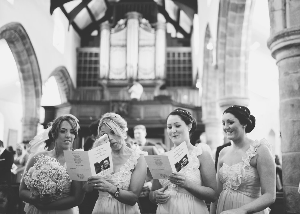 A few bridesmaids tearing up during the ceremony- Relaxed rustic themed wedding in ribble valley