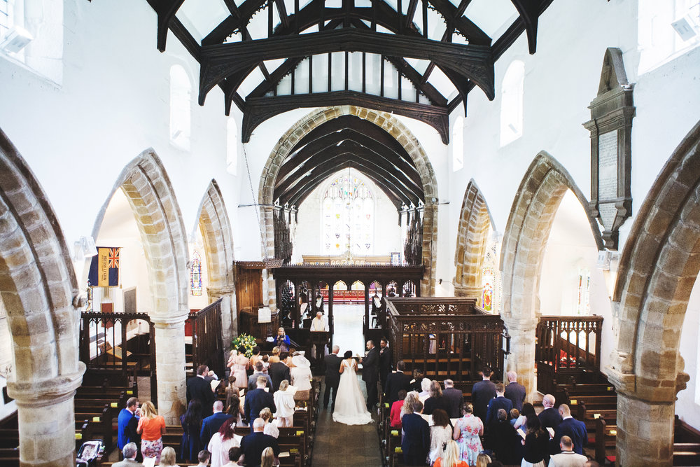 The bride and her father walking down the aisle- Whalley Abbey Wedding venue, ribble valley