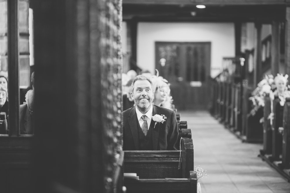 The father of the bride smiling- Black and white wedding photography in lancashire