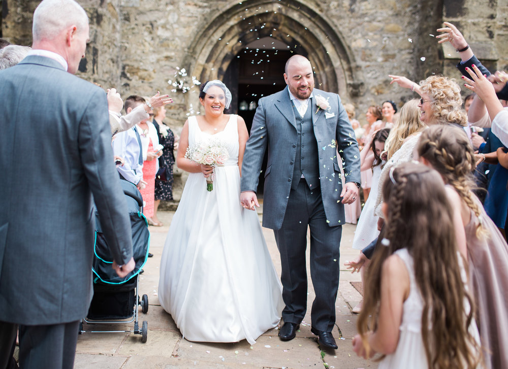 Confetti being thrown at the newly weds- Documentary wedding photography in lancashire