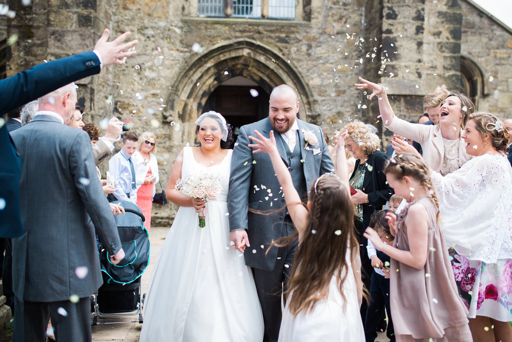 Air filled with confetti at Whalley Abbey- Creative wedding photography in Lancashire
