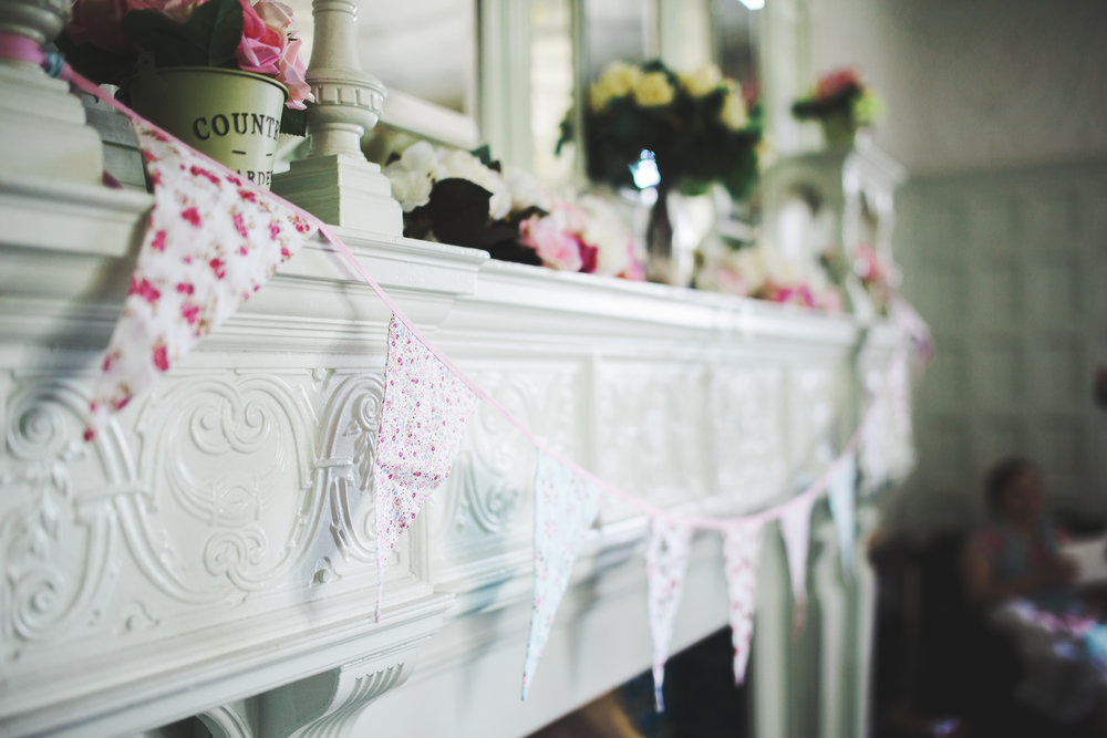 Pink floral bunting for the rustic themed wedding- Lancashire photographer in ribble valley, Whalley Abbey for a wedding