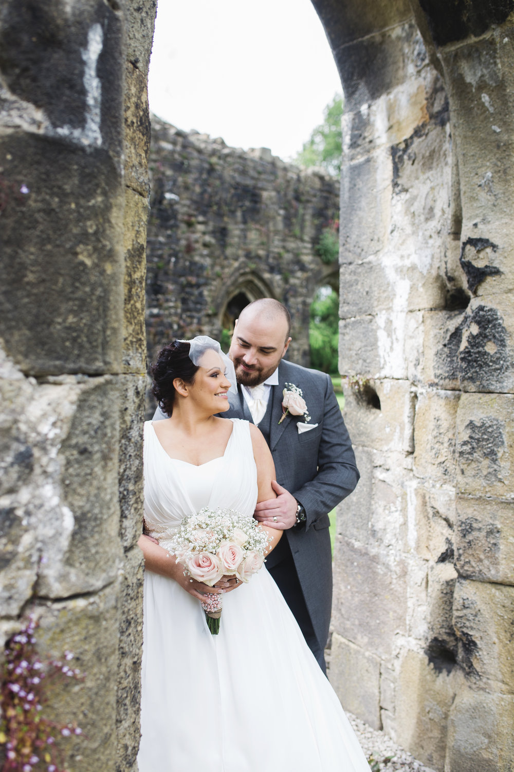 Portrait of the bride and groom in Whalley Abbey- Documentary styled wedding photography