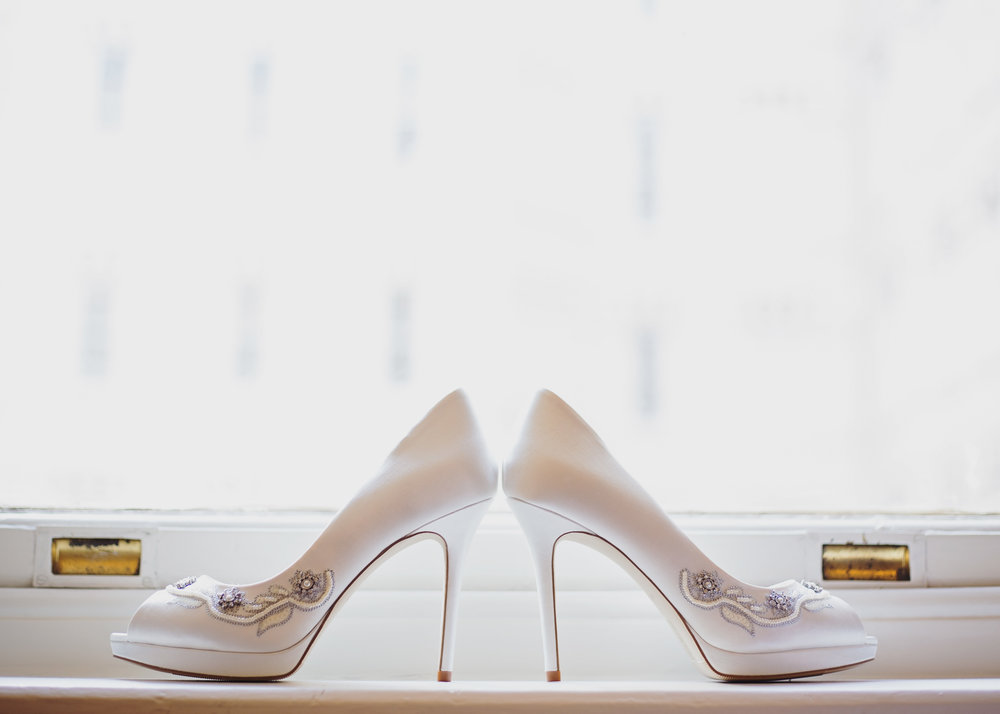 The bridal shoes on the window ledge- Creative photography in manchester