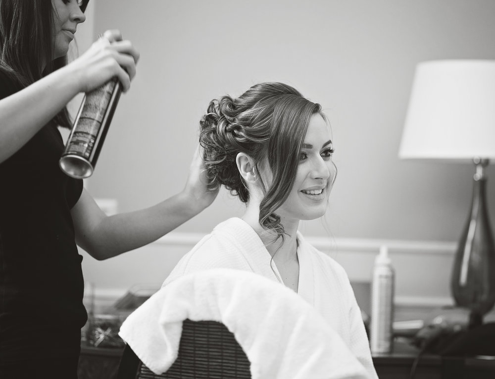 The bride getting her hair done, black and white photography