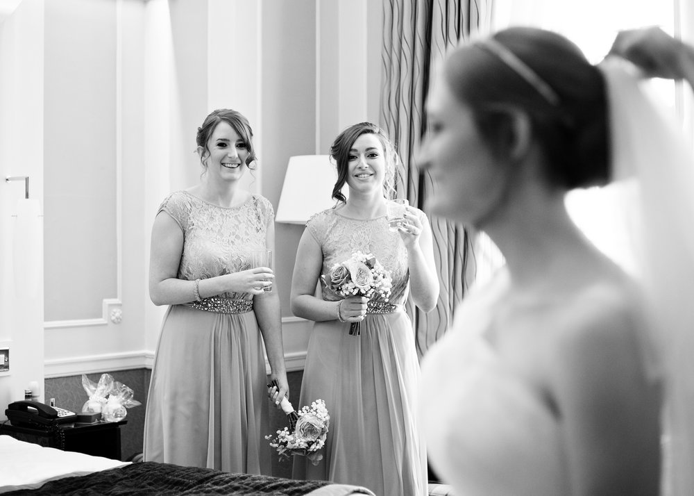 The bridesmaids in the distance- Creative wedding photography