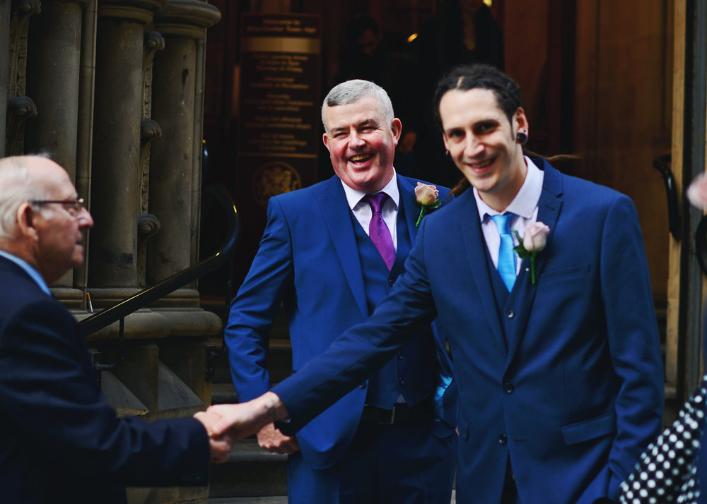 The groom and groomsmen outside of the Manchester Town Hall- Documentary wedding photography