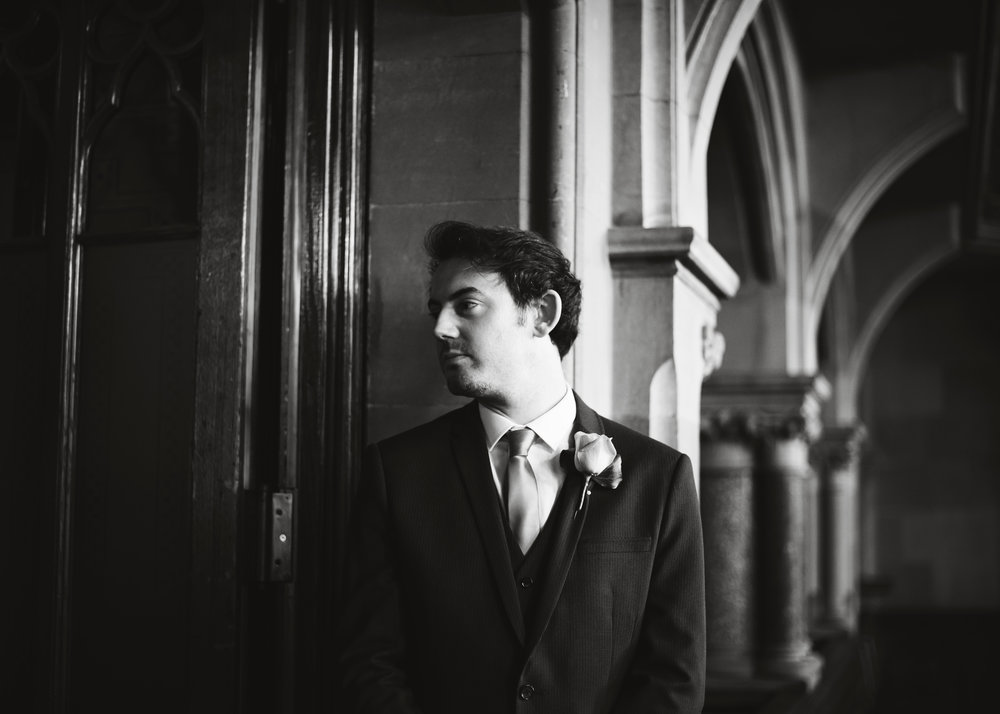 Black and white photograph of the best man- Creative wedding photography