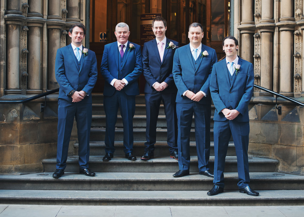 The groom surrounded by his groomsmen at Manchester Town Hall- Documentary styled wedding photography