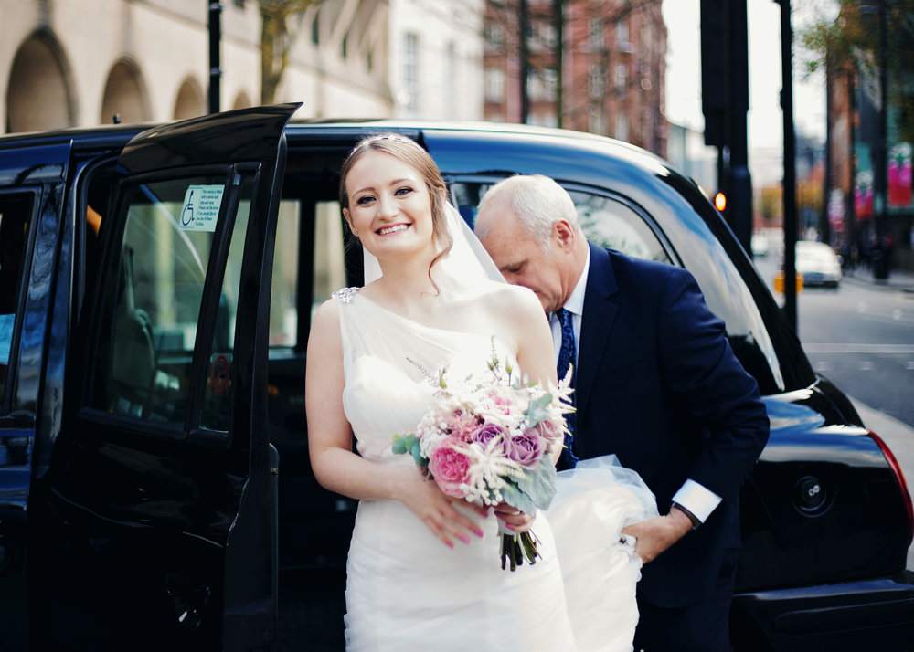 The bride getting out of her wedding car at Manchester Town Hall- Lancashire wedding photography in manchester