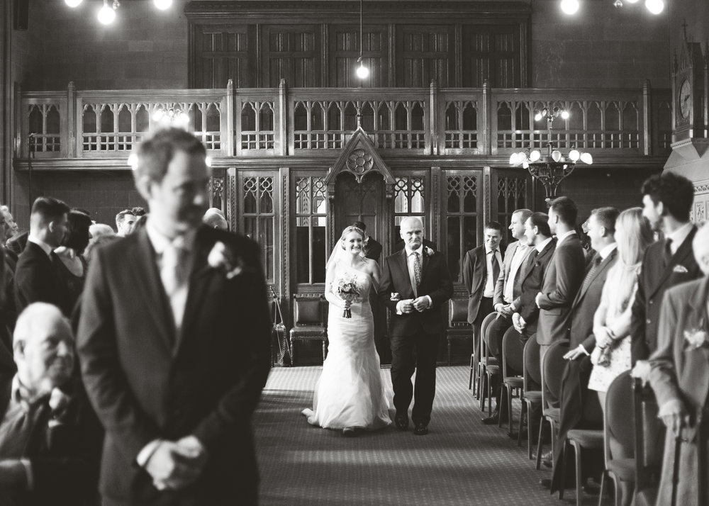 The bride and groom walking down the aisle- Creative wedding photography