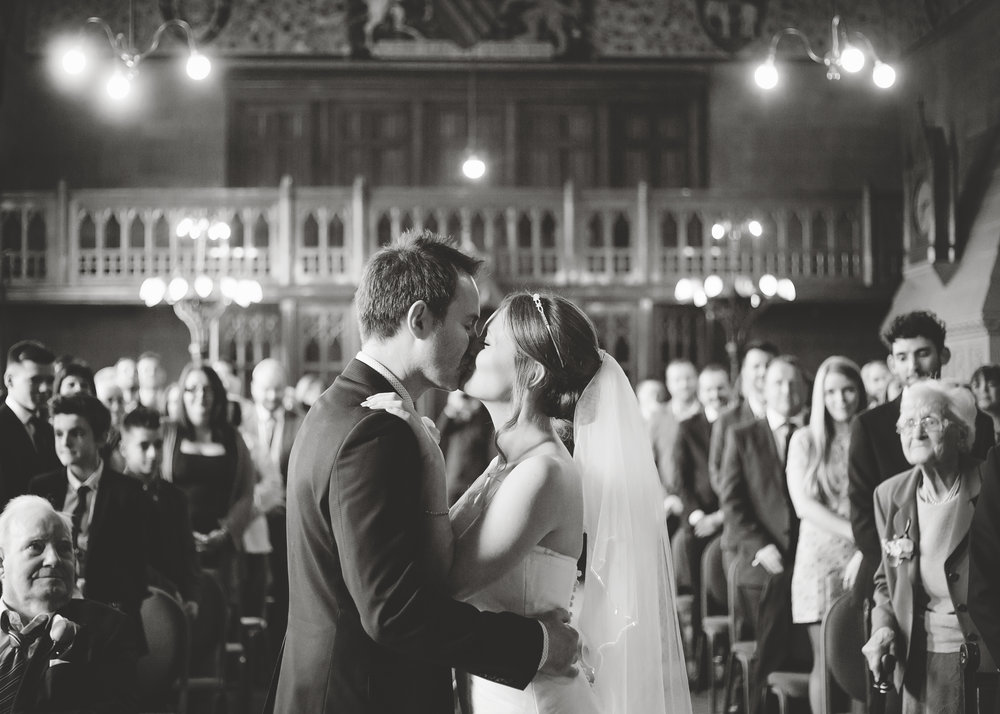 Bride and groom kissing at Manchester Town Hall