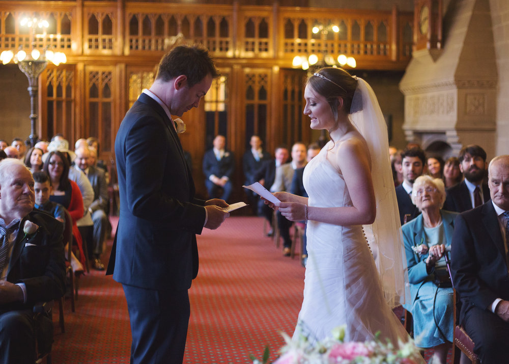 Bride and groom reading their vows at Manchester Town Hall- Documentary wedding photography