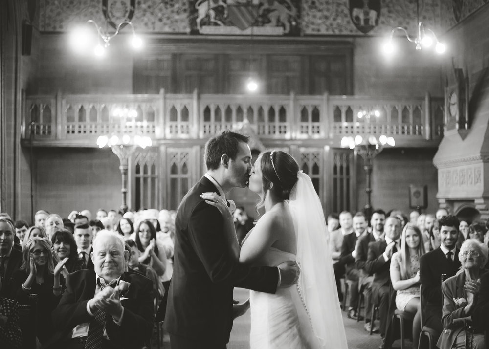 The bride and groom at the alter in Manchester Town Hall- Black and white photography