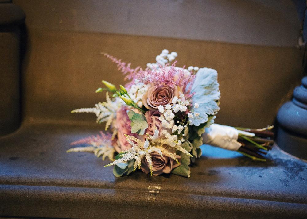 Creative wedding photographs of the wedding flower bouquet -Manchester Town Hall