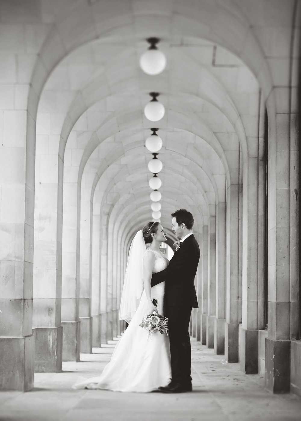 Black and white photogprah of the bride and groom at Manchester Town Hall- Creative documentary styled wedding photography
