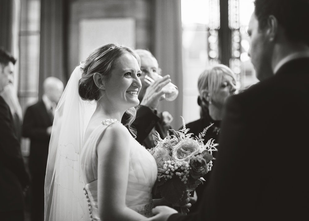 Smiles from the bride in black and white- Creative wedding photographer in manchester