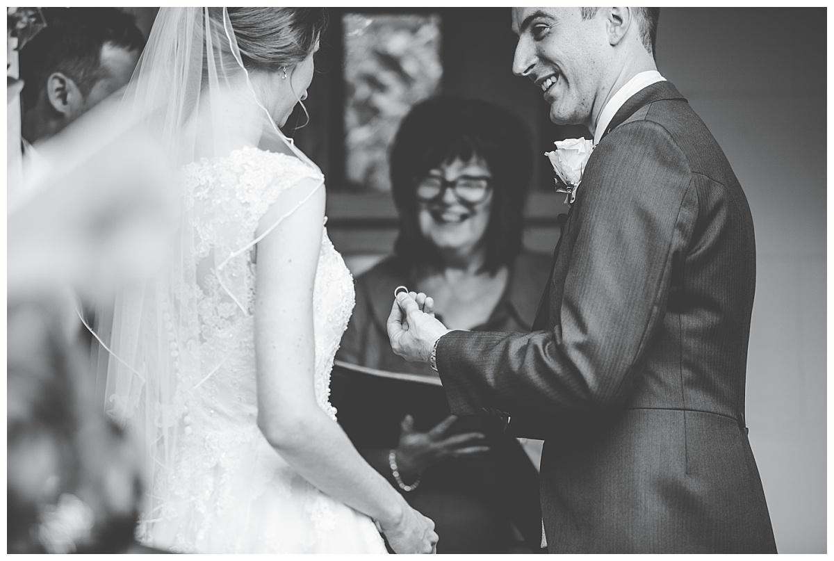 exchange of the rings - wedding photographer cheshire