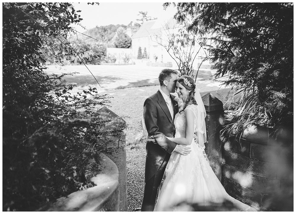 Black and white photograph of the bride and in the woodland area- Nature wedding photography, creative wedding