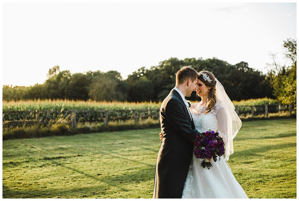 Creative wedding photograph of the bride and groom as the sunsets of wellington hall hotel- documentary wedding photography in cheshire