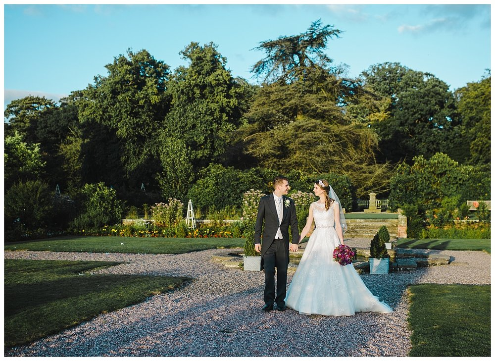 The bride and groom outside of wellington hall in cheshire