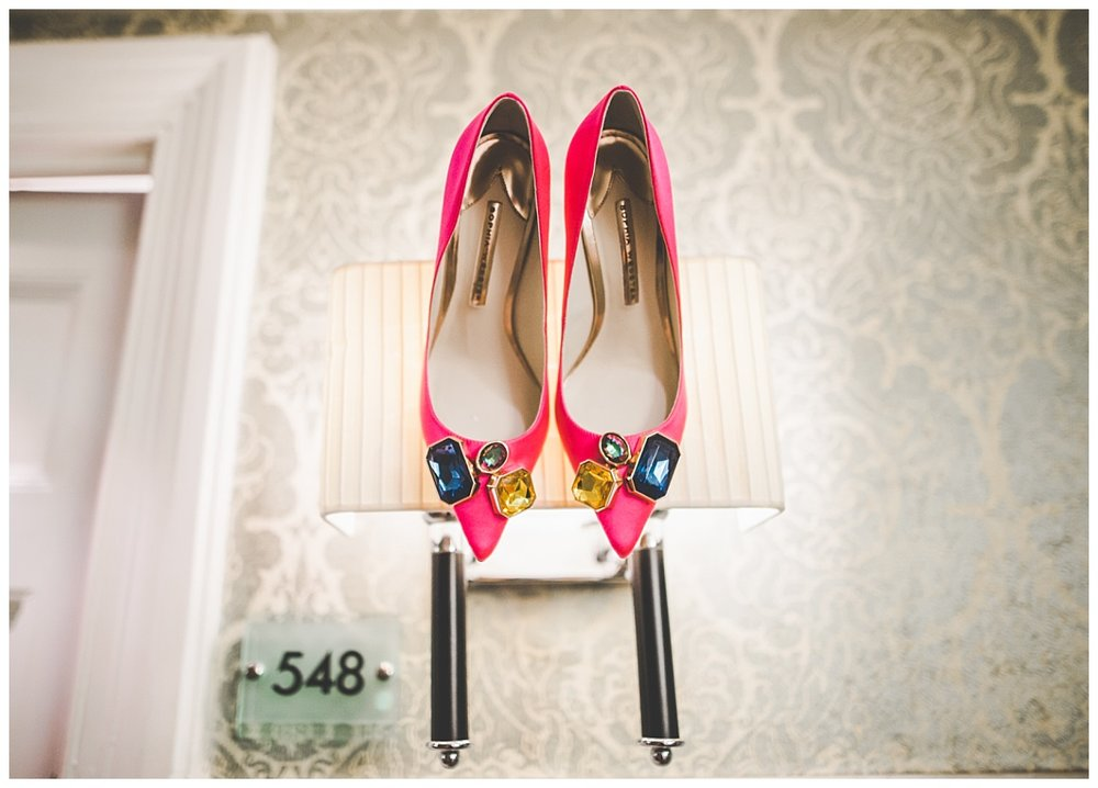 The brides pink wedding shoes- Creative shoes Creative wedding photographer