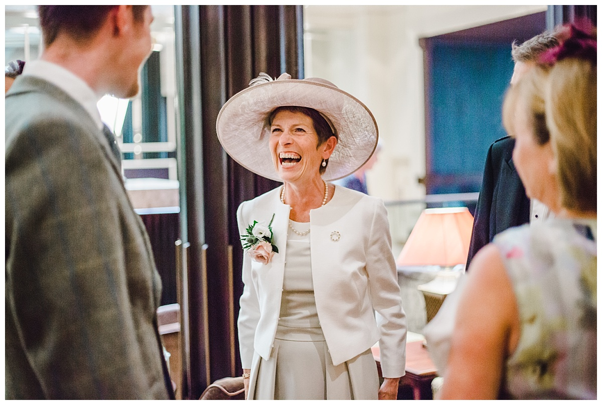 documentary wedding photography - laughing guest