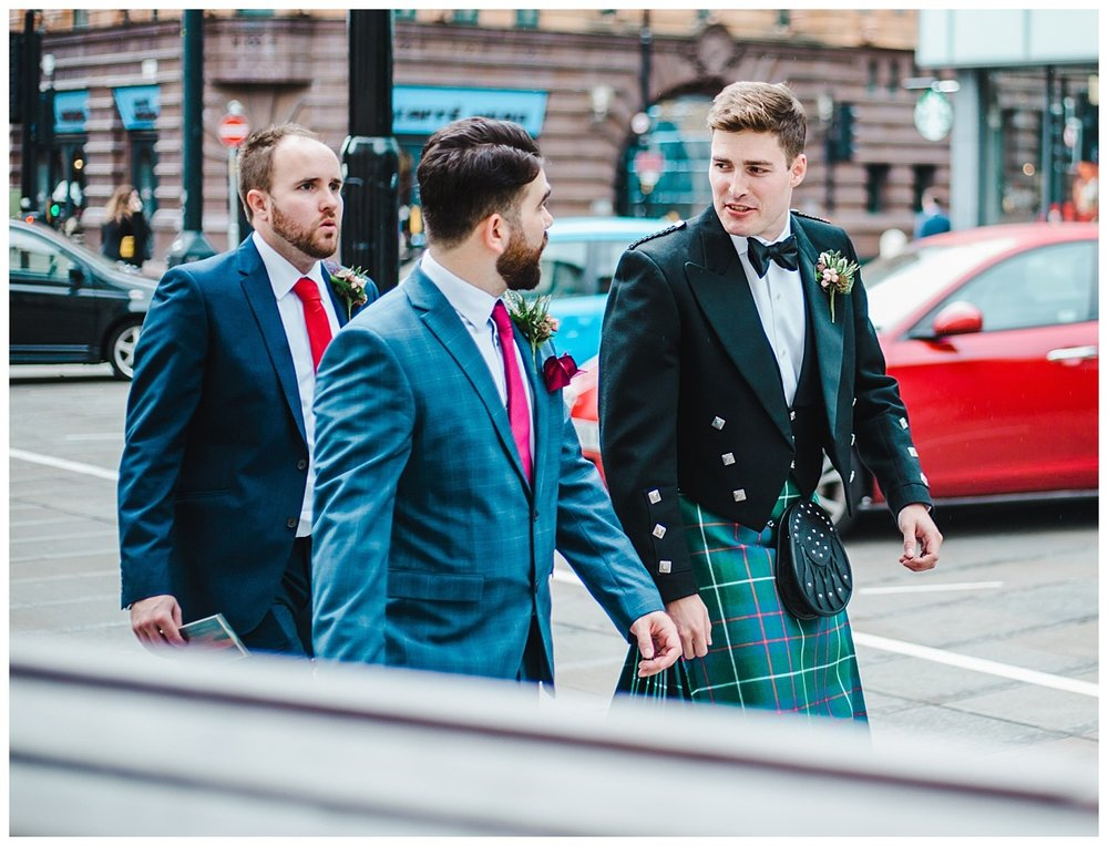 The groom and groomsmen walking the streets of manchester - Manchester town hall wedding venue