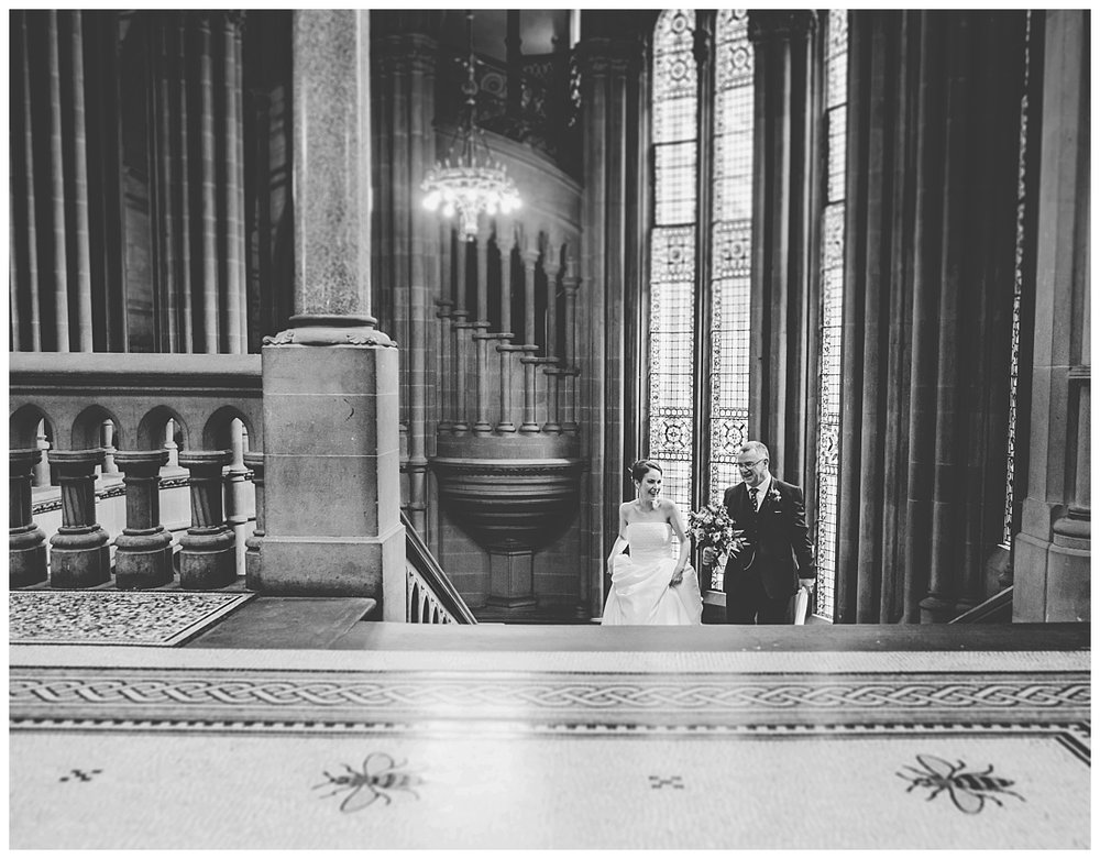 The bride and her father walking up the stairs at manchester town hall- Manchester wedding photographer at the town hall