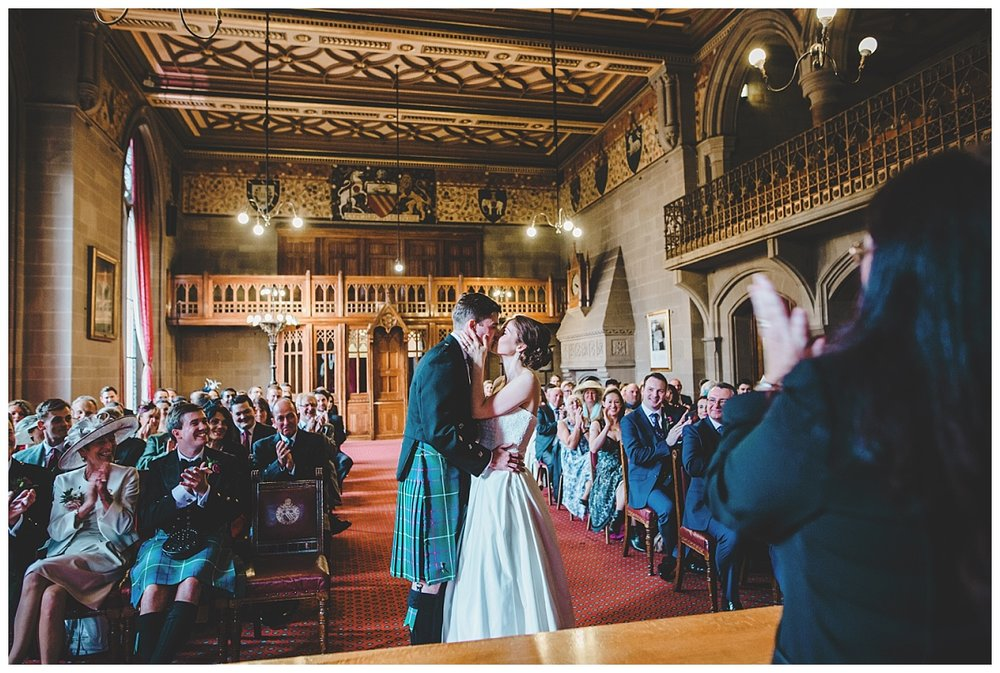 First Kiss - bride and groom at manchester town hall