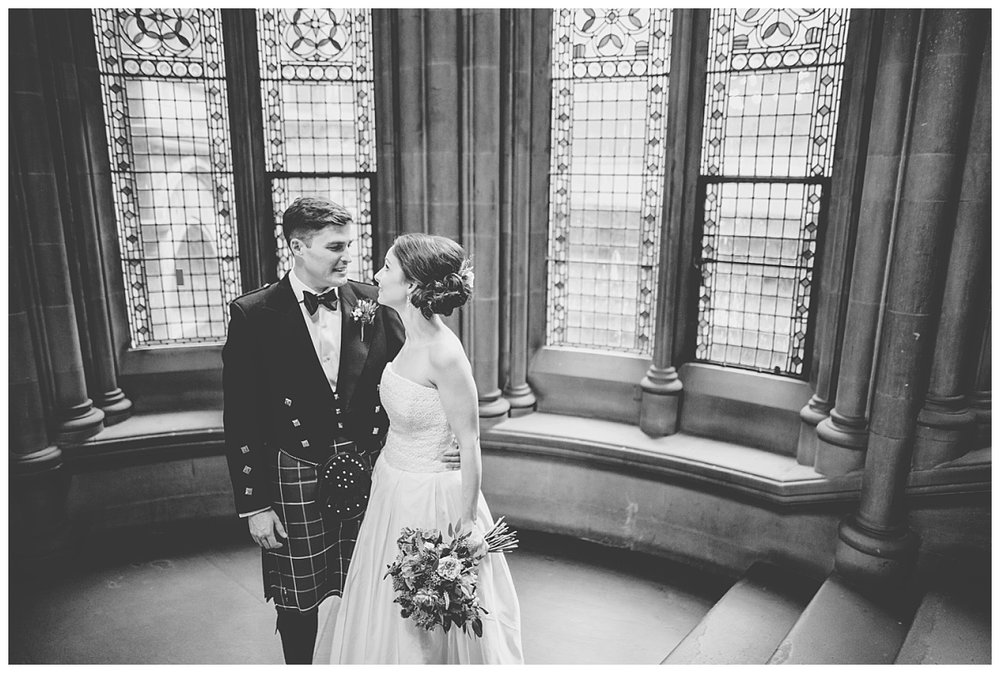 Black and white photograph of the bride and groom at manchester town hall
