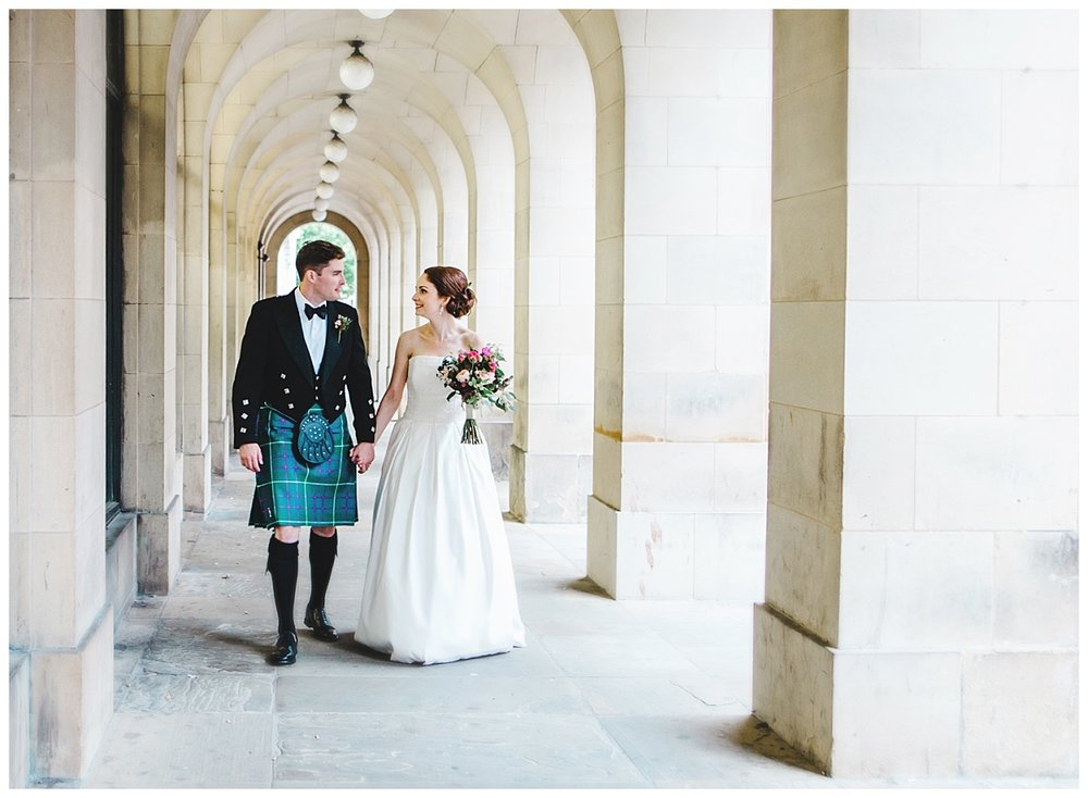 The bride and groom hand in hand at the manchester town hall- Creative relaxed wedding photographer