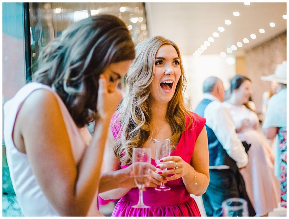 Big laughs from the wedding guests at Whitworth Art Gallery- Creative wedding photography