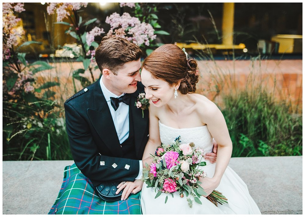 The bride and groom sat outside of Whitworth Art Gallery- Creative wedding photographs