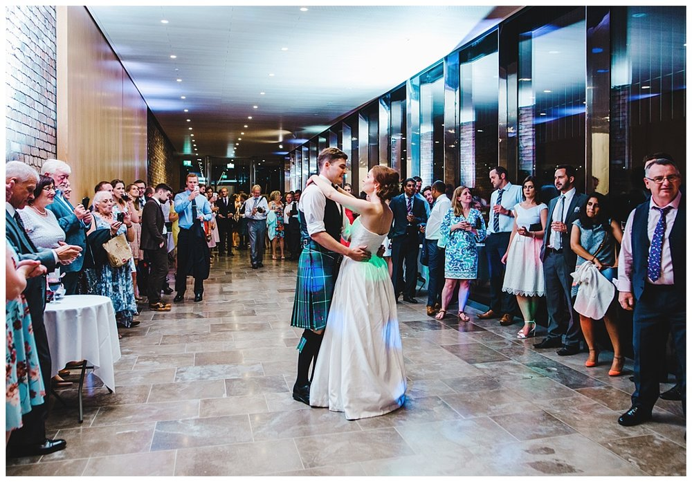 The bride and groom first dance at Whitworth Art Gallery- Documentary wedding photography