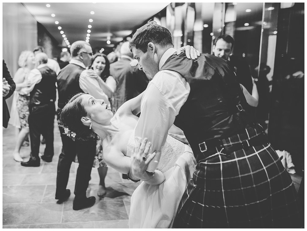 Bride and groom dancing on the dance floor- black and white photography