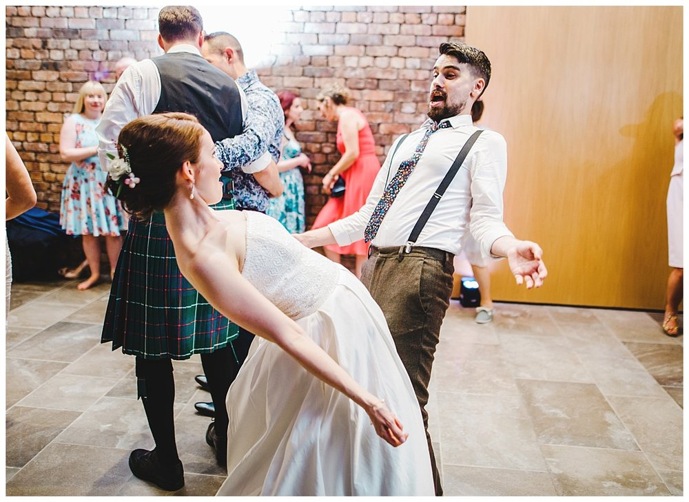 dancing on the dance floor for all of the wedding guests- Creative relaxed wedding photographer at Whitworth Art Gallery