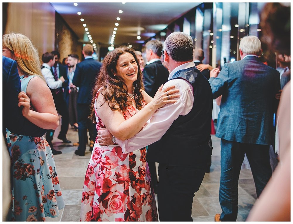 Wedding guest on the dance floor at Whitworth Art Gallery- documentary wedding photographer