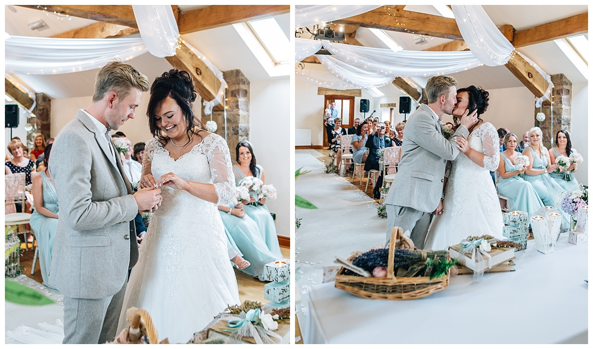 exchanging rings and first kiss - wedding ceremony Beeston Manor