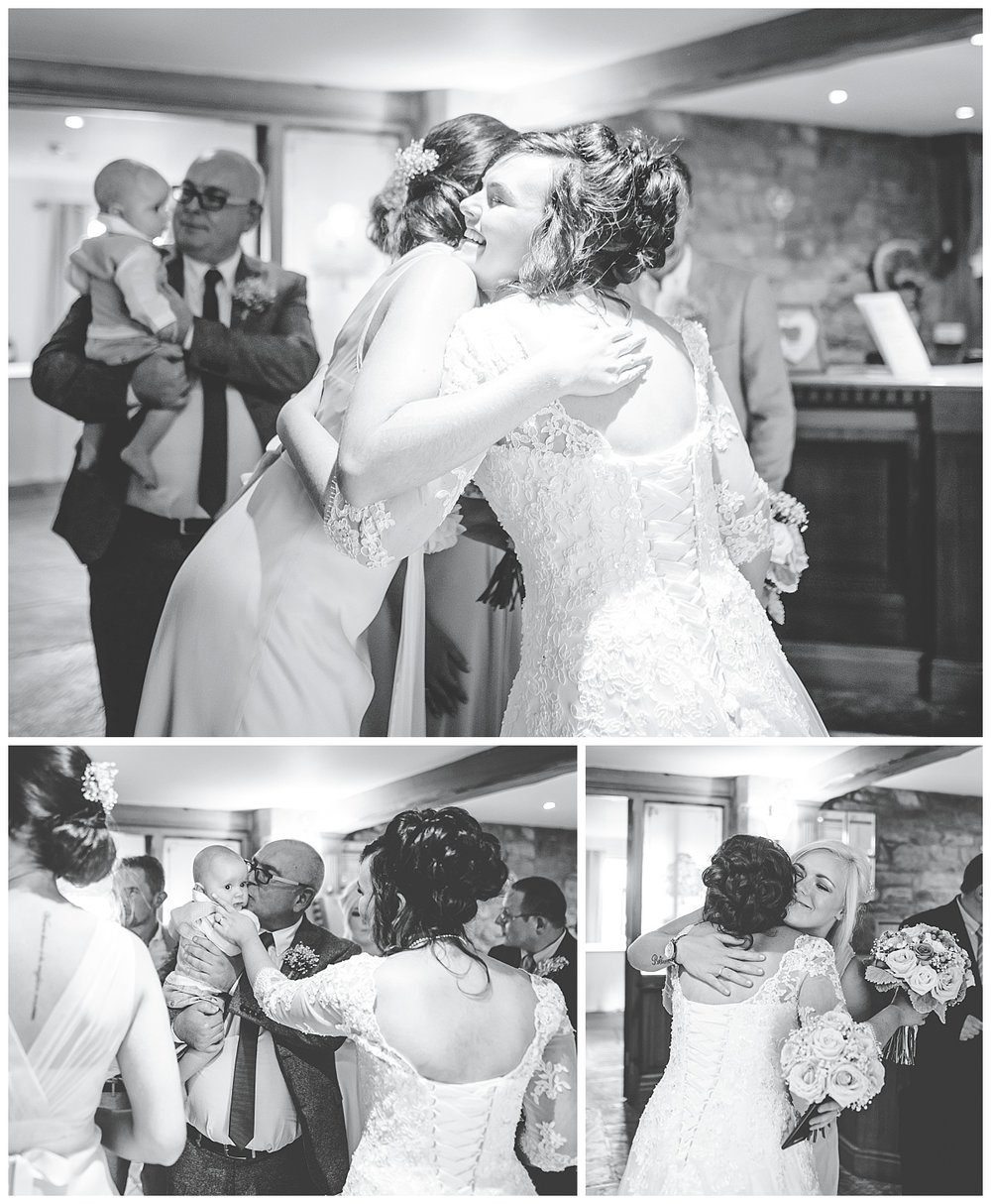 Hugs from the bride to wedding gguests- Black and white wedding photography in lancashire