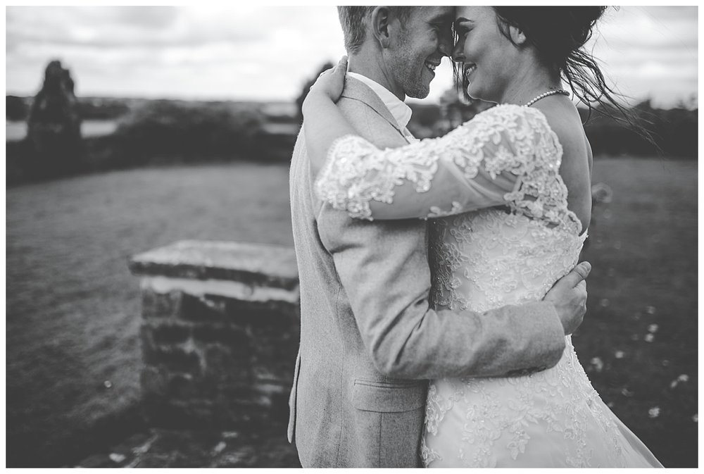 Black and white natural photograph of the bride and groom at Beeston Manor