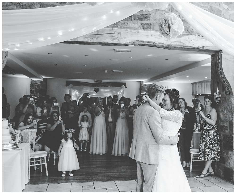The bride and grooms first dance, black and white photography