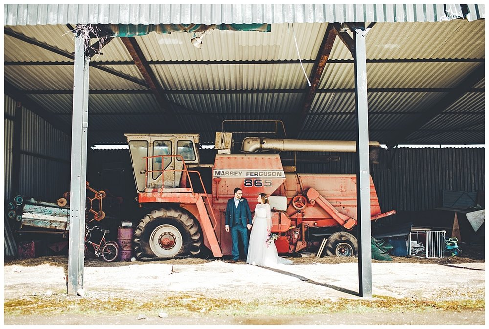 rustic country wedding inspiration - bride and groom in farmyard - wedding photographer in Cheshire